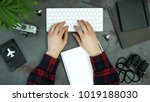 dark table with man's hands... | Shutterstock . vector #1019188030