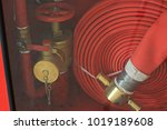 fire extinguisher and fire hose ... | Shutterstock . vector #1019189608