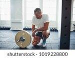 senior man in sportswear... | Shutterstock . vector #1019228800