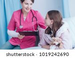 smiling doctor in pink uniform  ... | Shutterstock . vector #1019242690