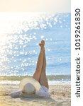 young woman lies on the beach...   Shutterstock . vector #1019261830