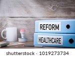 healthcare reform. two binders... | Shutterstock . vector #1019273734