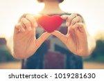women hand holding red heart... | Shutterstock . vector #1019281630