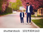 happy father and son walking... | Shutterstock . vector #1019304163
