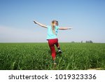 cute girl jumping in the field | Shutterstock . vector #1019323336