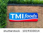 Small photo of Northampton UK January 11 2018: TMI Foods logo sign exterior