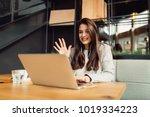 girl making a video call online ... | Shutterstock . vector #1019334223