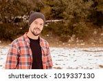 pensive man with beard plaid t... | Shutterstock . vector #1019337130