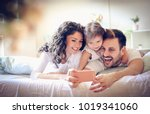 happy young family take a self... | Shutterstock . vector #1019341060