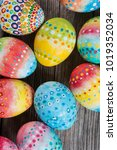 easter painted eggs on a wooden ... | Shutterstock . vector #1019352034