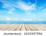 Wooden Floor With Blue Sea And...