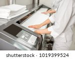 ironing bedclothes with... | Shutterstock . vector #1019399524