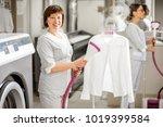portrait of a senior washwoman... | Shutterstock . vector #1019399584