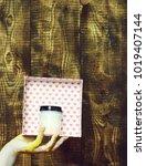 female hand smeared in golden...   Shutterstock . vector #1019407144