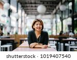 mature and attractive asian... | Shutterstock . vector #1019407540