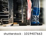 Operating Forklift Truck. Men and the Machine. Professional Lift Truck Operator Concept Photo. - stock photo