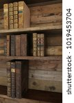 antique books on old wooden... | Shutterstock . vector #1019453704