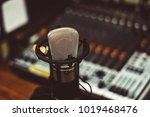 microphone and mixing console | Shutterstock . vector #1019468476