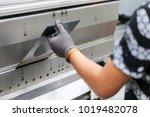 worker operator bending metal... | Shutterstock . vector #1019482078
