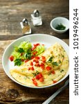 Small photo of Homemade French omelette with capsicum and herbs