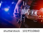 man playing guitar on a stage... | Shutterstock . vector #1019510860