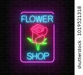 glowing neon sign of flower... | Shutterstock .eps vector #1019521318