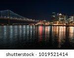 night cityscape of illuminated... | Shutterstock . vector #1019521414