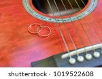 red guitar and two alliances | Shutterstock . vector #1019522608