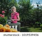 woman relaxing on balcony   Shutterstock . vector #1019539456