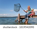 Mother And Daughter Fishing...