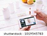 hands of aged patient... | Shutterstock . vector #1019545783