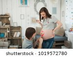 pregnant woman with big belly.... | Shutterstock . vector #1019572780