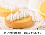 lemon pie on the table with... | Shutterstock . vector #1019593750