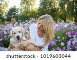 beautiful girl playing with a...   Shutterstock . vector #1019603044