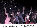 group of dancing friends... | Shutterstock . vector #1019605033