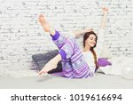 young woman in bed relaxing and ... | Shutterstock . vector #1019616694