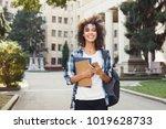 happy smiling african american... | Shutterstock . vector #1019628733