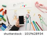 top view on fashion designer at ... | Shutterstock . vector #1019628934