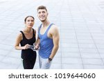 happy man and woman standing ... | Shutterstock . vector #1019644060