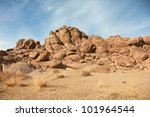 Red Rocks In The Barren Sands...