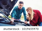 couple on the road having... | Shutterstock . vector #1019655970