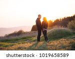 a loving young couple at... | Shutterstock . vector #1019658589