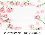 Stock photo flowers composition frame made of pink rose flowers on white wooden background flat lay top view 1019680606