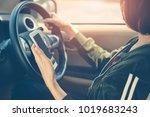 women driver using smart phone... | Shutterstock . vector #1019683243