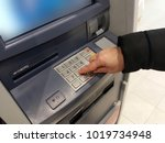 close up of hand entering pin... | Shutterstock . vector #1019734948