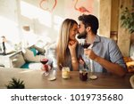 happy couple drinking red wine... | Shutterstock . vector #1019735680