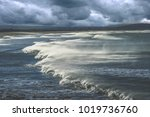 rough sea and big waves on the... | Shutterstock . vector #1019736760