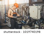 worker at the factory | Shutterstock . vector #1019740198