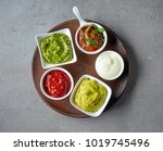 various dip sauces on grey... | Shutterstock . vector #1019745496