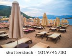 sun loungers on a beach in... | Shutterstock . vector #1019745730
